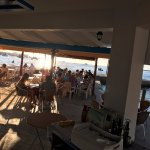 the beach restaurant opposite marina playa hotel , serves excellent food and tapas.