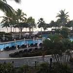 view of the pool from the foyer at sunrise