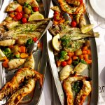 Two mixed grilled seafood platters for 4 people