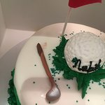 paint on cake next to golf club