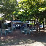 The restaurant, also has seating under the trees.
