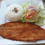 Pescado Empanado (fried fish). You can have black beans instead of salad.