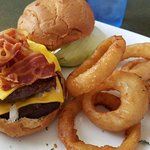 Double Black Angus Cheeseburger, with choice of cheese shown with bacon, lettuce, onion and toma