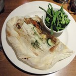 Sea Bass with mixed vegetables and potatoes artfully served in parchment wrap