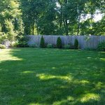 Very large, beautiful grassy area in back with a fountain, seating, and nice landscaping and flo