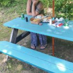 My beautiful wife on the only seating, picnic table 'round back