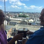 Enjoying the view and a Guinness in the Guinness Storehouse top floor lounge.