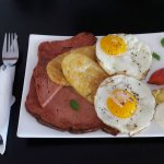 German meatloaf breaky with fried eggs and hash browns