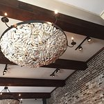 Creative use of oyster shells in a lighting fixture