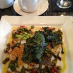 Grilled steelhead with kale chips and vegetables.