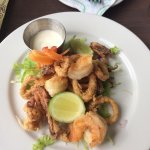 The calamari was over cooked and bland but everything else was awesome. The bartender was very f