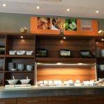 Well stocked buffet breakfast area.
