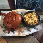 Bacon cheese burger with mac n cheese on branded brioche bun