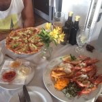 Mouth watering, fresh KING prawns and a delicious, thin based wood fired pizza