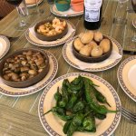 Shrimps with garlic, Canarian potatoes, mushrooms with garlic and pimientos del padron