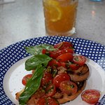 BRUSCHETTA Slices of grilled ciabatta with delicious fresh baby plum tomatoes, basil & garlic