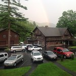 The view from the Adirondack chairs on our cabins porch. Rainbow above lodge first night.