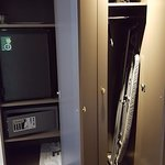 Closet in room with safe, minibar etc