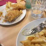 Childrens cod and chips on the left, served on a smaller plate