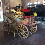 An antique buggy in the stable.