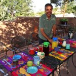 Shaan setting up breakfast on the patio