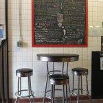 Interior seats and chalk board menu.