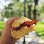 bacon egg and cheddar on a biscuit