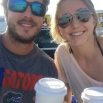 sitting on the tailgate to finish our coffee from Baby's. Happy Campers!