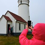 Anita takes pics of Mike and Jan at the Lighthouse...windy!