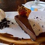 Chocolate tort with chocolate sauce and homemade ice cream