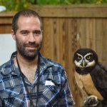 Kevin holding an owl