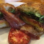 The OMG BLT on a rosemary focaccia roll with house made pesto mayonnaise