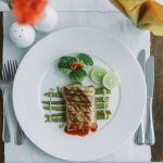 Grilled Nile Perch served on a bed of asparagus