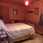 Jennies Room finds a double bed, hand made quilt. and that old fashion bed made of iron.