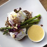 Poached egg special on gluten-free seed bread with asparagus and hollandaise.