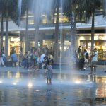 Kids playing in the fountains outside.