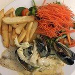 Grilled barramundi, mussel and squid sauce