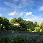 A view of the house from the petanque court, over the tennis court