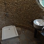 River stone clad bathroom