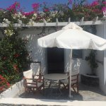 Super cute room with small terrace and bougainvillier flower.  Just a perfect sport in Oia and l