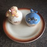 Two imaginative cup cakes made by Heather.