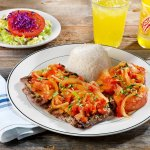 CARNE A LA CRIOLLA: Steak and potatoes with onions & tomatoes sauce, cilantro, rice + salad