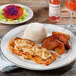 POLLO ENCEBOLLADO: Grilled chicken with sauteed onions, rice, sweet plantains + salad