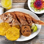 PARGO FRITO CON ARROZ CON COCO: Whole Fried red snapper with coconut rice, green plantains + sal