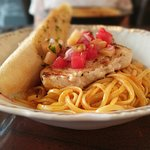 Swordfish and pasta with mango watermelon salsa, grilled pinapple, and curry coconut sauce. Beau