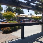 Outdoor seating facing an outdoor seating annex and Stanford University