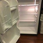 Empty fridge, no bottled water! ONE steak knife, marked up old furniture, rotten floorboards, pe