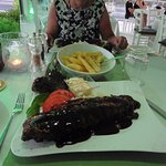 Ribs on a bed of rice, Salad and Chips