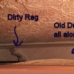 Behind bed dirty rag and very old dust