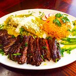 Carne Asada or Tampiquena is a great grilled steak, pared with refriedbeans, rice and corn torti